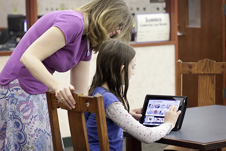 Happy teacher and student reviews the Avatalker AAC app