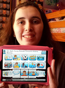 Happy young adult reviews the Avatalker AAC app